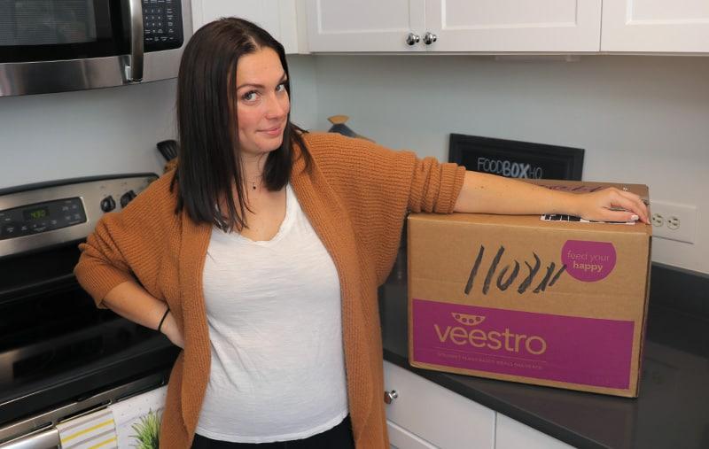 Emily Next To Veestro Box